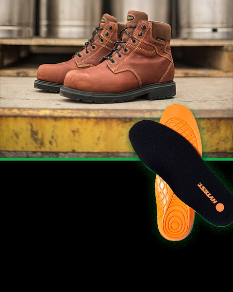 A pair of Hytest boots on concrete, and a pair of Hytest insoles.