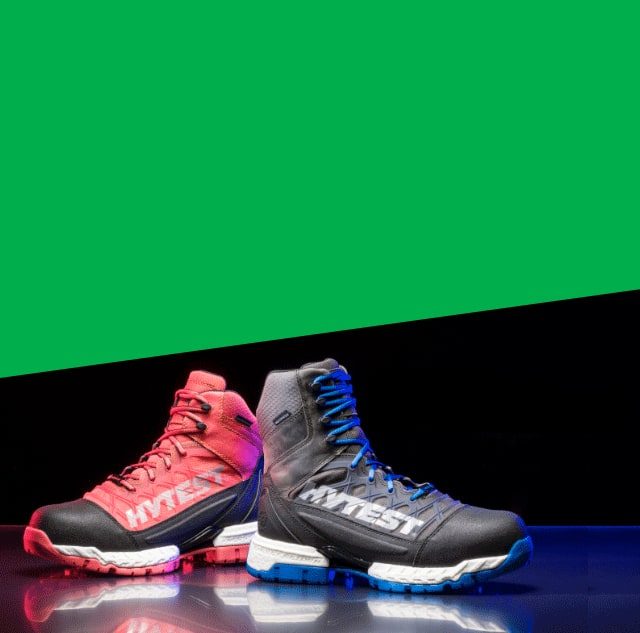 A pair of black Hytest Footrests 2.0 Rebound Hiker boots.
